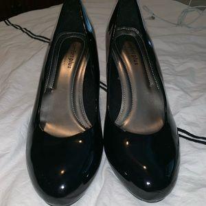 Shiny Black heels.